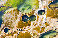 Aerial view of an attractive woman floating at figure eight pools at Sydney's Royal National Park, Australia.