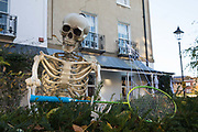 A skeleton is positioned outside a house to mark Halloween on 31 October 2020 in Windsor, United Kingdom. Halloween celebrations, and in particular the custom of trick-or-treating, will vary across the UK this year due to coronavirus restrictions which differ by Tier alert levels and the Prime Minister's official spokesman has urged people to apply common sense.