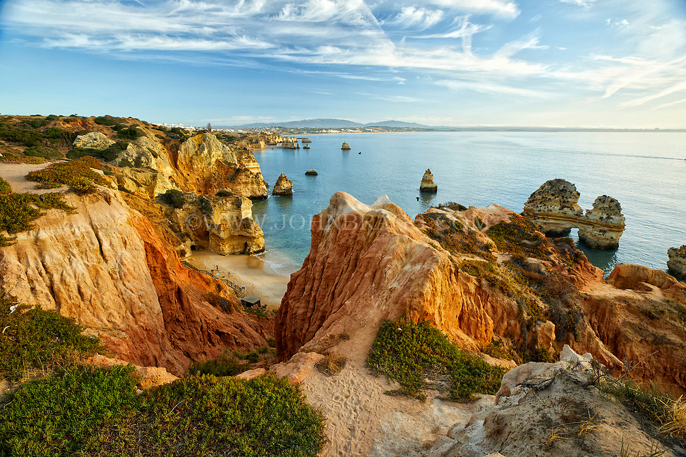 The sun rises on Camilo beach in the town of Lagos in the Algarve region of southern Portugal.