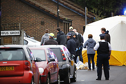 © Licensed to London News Pictures. 11/12/2015. London, UK. Police at the scene of a shooting in North London following an an intelligence led operation. Photo credit: Tolga Akmen/LNP