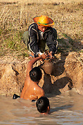 Thai men catch fish in natural fish ponds