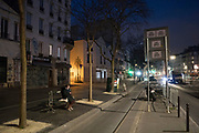 """March, 17th, 2020 - Paris, Ile-de-France, France: Boulevard Belleville almost deserted in the early evening during the first day of near total lockdown imposed in France, to combat the spread of Coronavirus. President of France, Emmanuel Macron, said the citizens must stay at home from midday on Tuesday for at least 15 days. He said """"We are at war, a public health war, certainly but we are at war, against an invisible and elusive enemy"""". All journeys outside the home unless justified for essential professional or health reasons are outlawed. Anyone flouting the new regulations would be punished. Nigel Dickinson"""