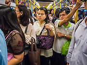 "22 AUGUST 2013 - BANGKOK, THAILAND:    Commuters on the Airport Rail Link, a train that connects Bangkok to Suvarnabhumi International Airport ride to work in Bangkok. Thailand entered a ""technical"" recession this month after the economy shrank by 0.3% in the second quarter of the year. The 0.3% contraction in gross domestic product between April and June followed a previous fall of 1.7% during the first quarter of 2013. The contraction is being blamed on a drop in demand for exports, a drop in domestic demand and a loss of consumer confidence. At the same time, the value of the Thai Baht against the US Dollar has dropped significantly, from a high of about 28Baht to $1 in April to 32THB to 1USD in August.    PHOTO BY JACK KURTZ"