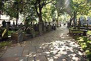 Lens flare, Graves in churchyard, Saint Nicholas Kirk, Aberdeen, Scotland