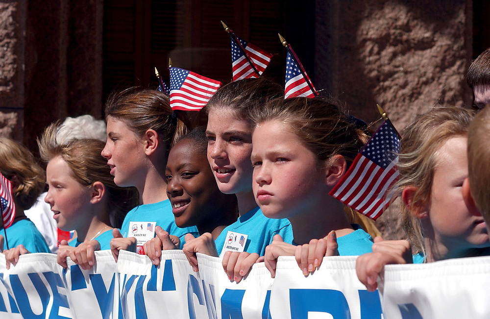 Austin, Texas 17OCT01: Schoolchildren from around Texas rally Wednesday at the Texas Capitol during an anti-drug rally and patriotic event to help kids resist drugs and peer pressure.  The event is in honor of Kiki Camarena, a Drug Enforcement Administration officer killed on duty in Mexico in 1995. ©Bob Daemmrich