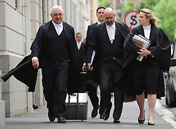 © Licensed to London News Pictures. 08/10/14. CAPE TOWN, SOUTH AFRICA -   Counsel for the defence, Francois van Zyl SC, walks with his team towards the court entrance during Day 3 of the Shrien Dewani trial at the Cape High Court before Judge Jeanette Traverso. Dewani is caused of hiring hit men to murder his wife, Anni. Anni Ninna Dewani (née Hindocha; 12 March 1982 – 13 November 2010) was a Swedish woman who, while on her honeymoon in South Africa, was kidnapped and then murdered in Gugulethu township near Cape Town on 13 November 2010. Photo credit : Roger Sedres/LNP
