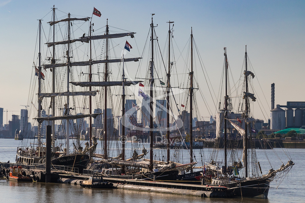 Woolwich, London, September 14th 2016. The late afternoon sun reflects off the hulls and spars of tall ships gathered for the Sail Greenwich Festival 2016 on the River Thames at Woolwich.  ©Paul Davey<br /> FOR LICENCING CONTACT: Paul Davey +44 (0) 7966 016 296 paul@pauldaveycreative.co.uk