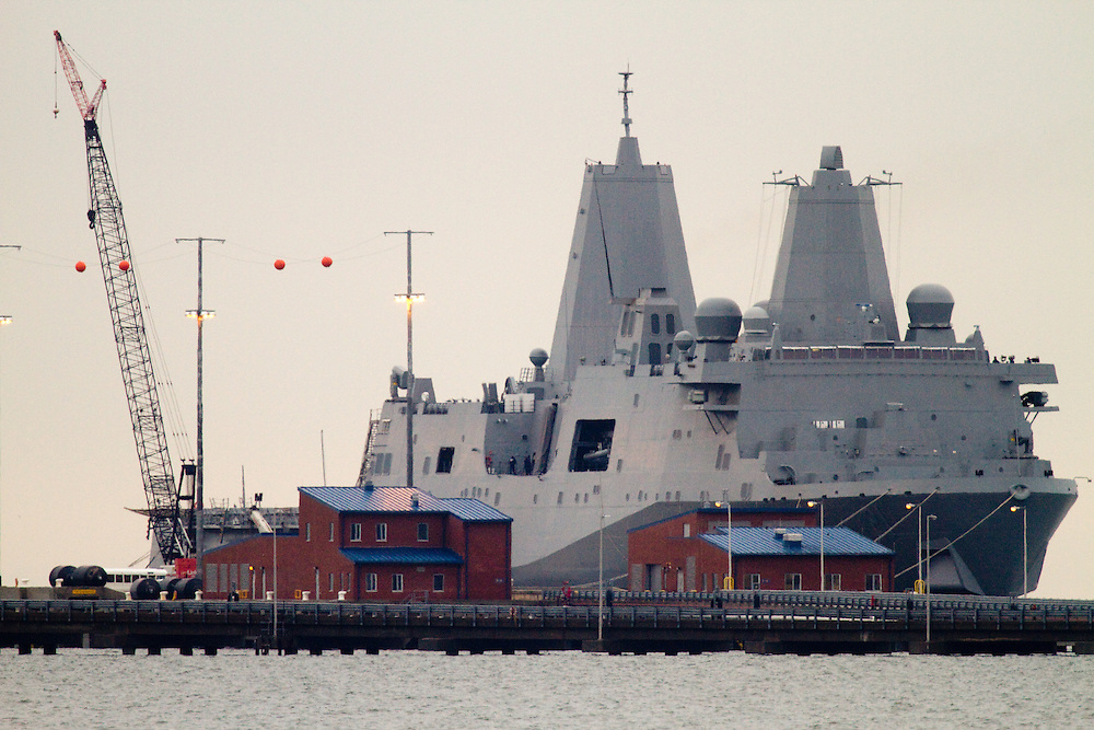 The USS New York built with steal salvaged from the World Trade Center Towers sails out to sea from the Sandy Hook Channel leaving the Navel Weapons Station Earle pier after being stuck in port due to a fierce   nor'easter storm that affected the area .