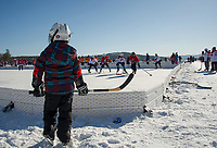 New England Pond Hockey Classic on Meredith Bay.  Karen Bobotas for the Laconia Daily Sun