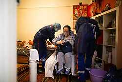 The patient is on oxygen bottle with a respirator on a wheel chair for transportation to the hospital. Orane and Nicolas, members of the Protection Civile wearing personal protection equipment (PPE) in Paris takes care of a asian women suspected of being infected by the coronavirus during an intervention. French first aid workers from the Protection Civile Paris Nicolas, Orane and Quentin takes care of Covid cases at their home as they are doing a guard by night to help the SAMU, They handle cases suspected being infected with the novel coronavirus at their home. Paris on April 19, 2020 during a lockdown in France to stop the spread of the COVID-19. France has been on lockdown since March 17 in a bid to limit the contagion caused by the novel coronavirus. Photo by Raphael Lafargue/ABACAPRESS.COM