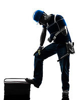 one injured manual worker man with injury brace in silhouette on white background