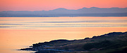 Sunset panorama from along the South Beach of San Juan Island in Washington state, with the Olympic Mountains visible in the distance.