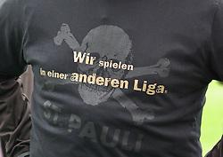"""09.05.2010, Millerntor-Stadion, Hamburg, GER, 2. FBL, FC St. Pauli vs SC Paderborn 07, im Bild T-Shirt mit der Aufschrift """"Wir spielen in einer anderen Liga""""   EXPA Pictures © 2010, PhotoCredit: EXPA/ nph/  Frisch / SPORTIDA PHOTO AGENCY"""