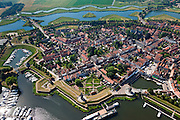 Nederland, Noord-Brabant, Gemeente Heusden, 08-07-2010; Heusden gelegen aan de Bergsche Maas, vestingstad met bastions of bolwerken en inclusief vestinggracht met ravelijnen. .Heusden, fortified town, situated on the Bergsche Maas, fortified with bastions ( ramparts) and moat with ravelins..luchtfoto (toeslag), aerial photo (additional fee required).foto/photo Siebe Swart