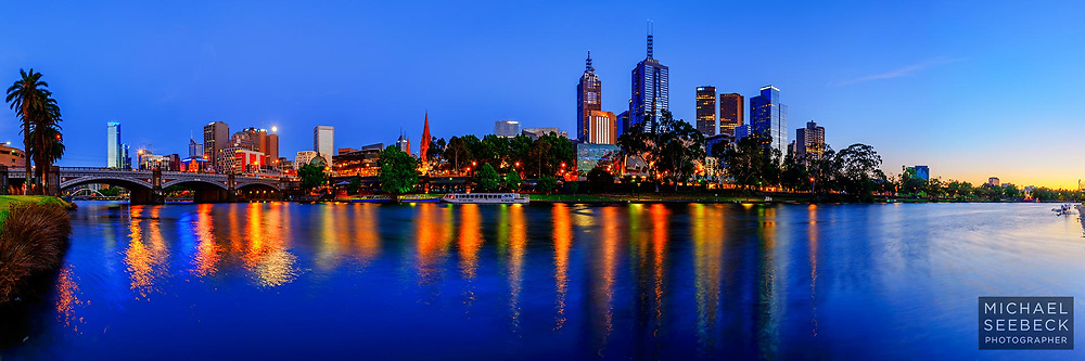 A panoramic photograph of the view of Melbourne across the Yarra River at dawn.<br /> <br /> Limited Edition of 125