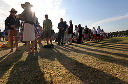 People queuing in Wimbledon Park on day two of the Wimbledon Championships at the All England Lawn Tennis and Croquet Club.