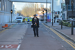 © Licensed to London News Pictures. 20/12/2019. London UK: Police officers close off Victoria Dock road in Newham East London after a cashpoint machine was stolen from the Ibis hotel. Robbers had driven a van through the front of the hotel at around 5.00 am this morning, Photo credit: Steve Poston/LNP