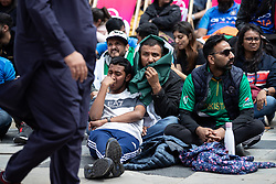 © Licensed to London News Pictures. 16/06/2019. Manchester, UK. Cricket fans watch India play Pakistan on a live screen in Cathedral Gardens , as the the two sides meet in the ICC Cricket World Cup at Old Trafford . Photo credit: Joel Goodman/LNP