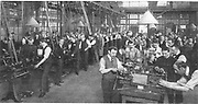 World War I - 1914-1918. British office workers, too old for military service, working as volunteers in a munitions factory in their spare time.