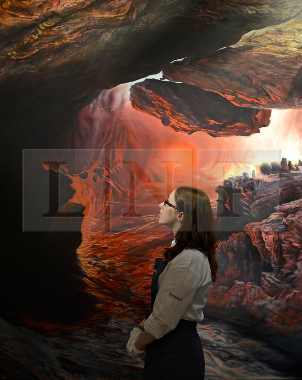 """© Licensed to London News Pictures. 14/06/2012. London, UK A woman is dwarfed by Glenn Brown's oil on canvas """"The Tragic Conversion of Salvador Dali (after John Martin). It is estimated to fetch between 2.2-2.8MillionGBP. Photocall for Sotheby's June Contemporary Art Evening Auction. Photo credit : Stephen Simpson/LNP"""
