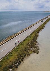 THEMENBILD - Strassenverkehr und Radfahrer auf der Landstrasse D75 umringt vom Wasser der Adria und der Einmündung des Flusses Mirna, aufgenommen am 03. Juli 2020 in Novigrad, Kroatien // Road traffic and Cyclist on the road D75 surrounded by the Water of the Adriatic Sea and the Mirna river confluence in Novigrad, Croatia on 2020/07/03. EXPA Pictures © 2020, PhotoCredit: EXPA/ JFK