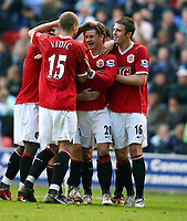Ole Gunnar Solskjaer Celebrates Scoring 3rd goal with team mates Michael Carrick/Nemanja Vidic and Louis Saha<br />Manchester United 2006/07<br />Wigan Athletic V Manchester United (1-3) 14/10/06<br />The Premier League<br />Photo Robin Parker Fotosports International
