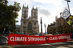 © Licensed to London News Pictures. 09/10/2019. London, UK. Campaigners from Extinction Rebellion movement set up a camping site outside Westminster Abbey on day three of the two weeks protest. The activists are calling for the government to act on climate change. Photo credit: Dinendra Haria/LNP