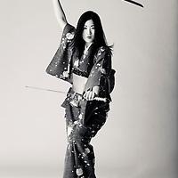 Sexy Japanese woman poses in kimono with katana, anime style