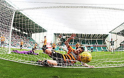 Hibernian's Jason Cummings scores their second goal and Alloa Athletic's Jason Marr can't stop shot.<br /> Hibernian 3 v 0 Alloa Athletic, Scottish Championship game played 12/9/2015 at Easter Road.