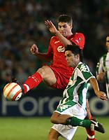Betis' Oscar Lopez chhallenged by Liverpool's Steven Gerrard during their Champions League match in Ruiz de Lopera stadium in Seville, Spain, Tuesday 13 September, 2005. (Photo / Alvaro Hernandez)
