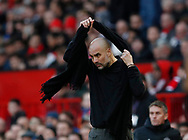Josep Guardiola manager of Manchester City puts on his scarf during the Premier League match at Old Trafford, Manchester. Picture date: 8th March 2020. Picture credit should read: Darren Staples/Sportimage