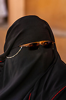 A woman wearing a burka, Valley of the Kings Archaeological site, near Luxor, Egypt