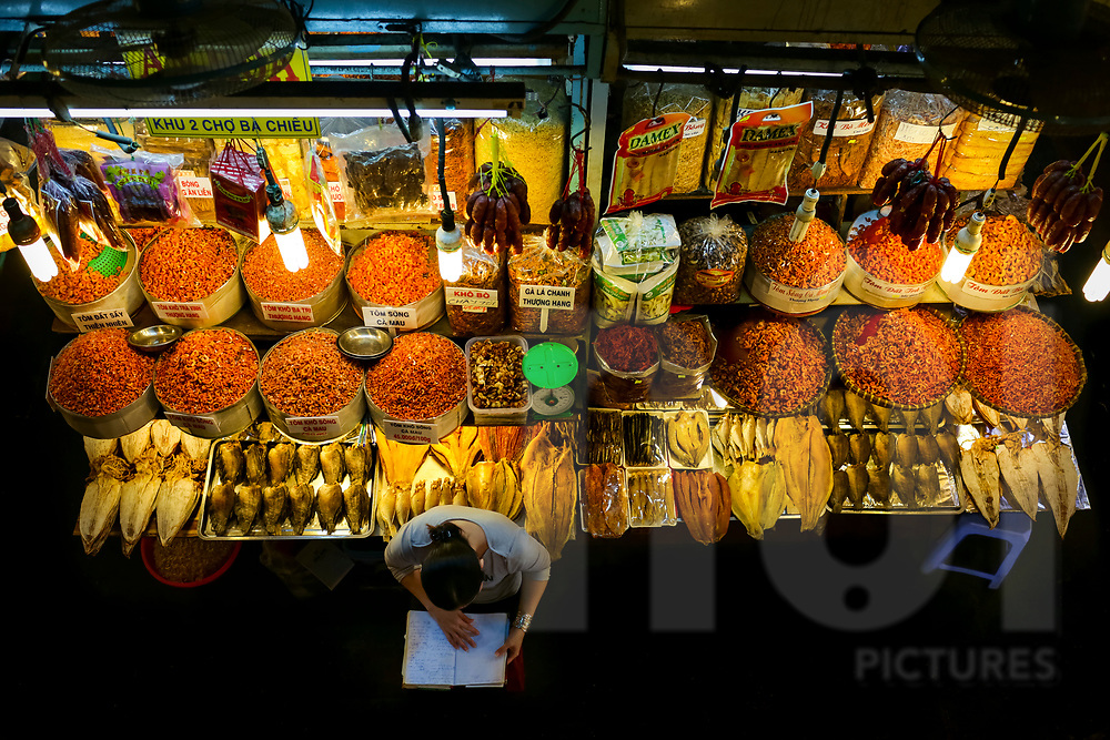 Above view of a dried products stall in a local market of Ho Chi Minh City, Vietnam, Southeast Asia