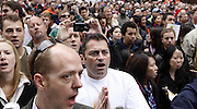 Tom Nibbio (cq center) and other Chicagoans react to the 2016 Olympic vote from Copenhagen in Daley Plaza on Friday, October 2, 2009. (Brian Cassella/Chicago Tribune)
