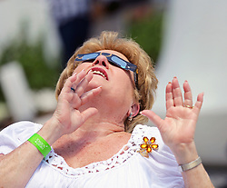 Berta Alder is fascinated as she views the partial eclipse of the sun from the bottom deck of the Frost Museum in downtown Miami, Fla. Photo by C.M. Guerrero/Miami Herald/TNS/ABACAPRESS.COM