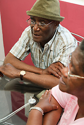 Elderly couple in meeting,