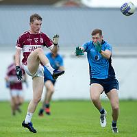 St. Joseph's Doora-Barefield's Cian McDonagh is blocked by Kildysart's Kieran O'Brien