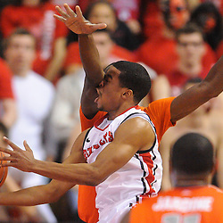Syracuse Orange center Baye Keita (12) fouls Rutgers Scarlet Knights guard Jerome Seagears (1) during first half NCAA Big East basketball action between #2 Syracuse and Rutgers at the Louis Brown Athletic Center. Syracuse leads 40-34 at halftime.