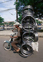 """Wheelrims transport, Saigon, Vietnam<br /> Available as Fine Art Print in the following sizes:<br /> 08""""x12""""US$   100.00<br /> 10""""x15""""US$ 150.00<br /> 12""""x18""""US$ 200.00<br /> 16""""x24""""US$ 300.00<br /> 20""""x30""""US$ 500.00"""