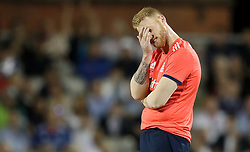 England's Ben Stokes shows his dejection as Pakistan's Sharjeel Khan hits for 4, during the Natwest T20 match at Old Trafford, Manchester.