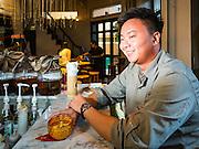 27 JANUARY 2016 - BANGKOK, THAILAND: A  man at the bar in Tep Bar, a new bar and restaurant in the Chinatown neighborhood of Bangkok.       PHOTO BY JACK KURTZ
