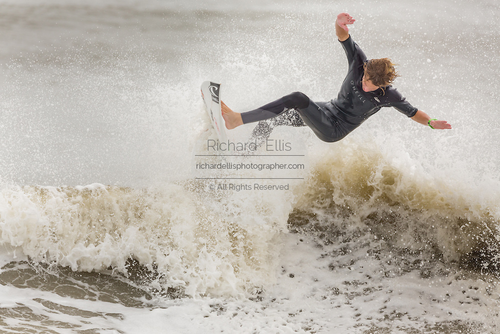 A surfers rides a wave at the Folly Washout as Hurricane Joaquin passes off shore bringing high surf and rip tides to the beaches along the South Carolina coast October 2, 2015 in Folly Beach, SC. Joaquin is expected to avoid the Carolinas but has already caused high surf and flooding.