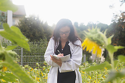 Female scientist inspecting plants at greenhouse, Freiburg im Breisgau, Baden-Wuerttemberg, Germany