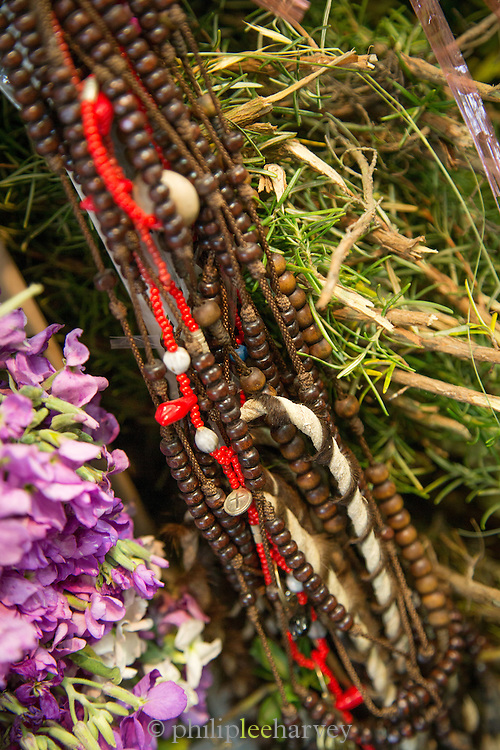 Rosary Beads used by a Natural Healer, Quito, Ecuador, South America Limpia is a cleansing procedure which is typical of Andean medicine. It involves the use of natural herbs, oils and rubs to cure diseases, reduce symptoms, and ward off spirits. San Roque Market, Ecuador, South America