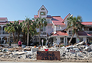 The Wood family recover what they can from the Driftwood Inn in Mexico Beach, Florida,  that was badly hit by Hurricane Michael