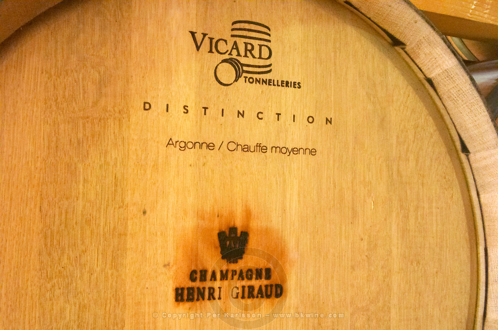 An oak barrel stamped with the winery's name and the cooper (Vicard Tonnelleries). This barrel is with oak from the Argonne forest not far from Champagne. This is the forest where historically barrels in Champagne came from. It is of the Distinction range and is Chauffe Moyenne medium toasted inside. Champagne house Maison Giraud-Hemart, also called Champagne Henri Giraud, Ay, Vallée de la Marne, Champagne, Marne, Ardennes, France, low light grainy grain