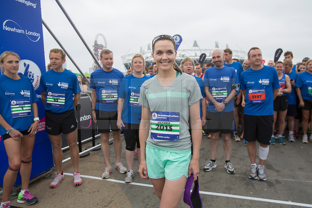 © licensed to London News Pictures. London, UK 21/07/2013. Victoria Pendleton attending The National Lottery Anniversary Run at Queen Elizabeth Olympic Park on Sunday, 21 July 2013 to support 12,500 runners. The Stadium at Queen Elizabeth Olympic Park open its doors to the public for the first time since London 2012. Photo credit: Tolga Akmen/LNP