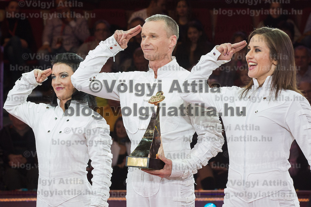 Laszlo Simet of Hungary and his partners celebrate winning the Golden Pierrot award during the 10th International Circus Festival in Budapest, Hungary on January 13, 2014. ATTILA VOLGYI