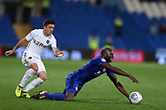 Pablo Hernandez of Leeds Utd (l) fouls Sol Bamba of Cardiff city. EFL Skybet championship match, Cardiff city v Leeds Utd at the Cardiff city stadium in Cardiff, South Wales on Tuesday 26th September 2017.<br /> pic by Andrew Orchard, Andrew Orchard sports photography.