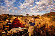 Tswalu Kalahari Reserve, the Oppenheimer family-owned reserve near the very small town of Vanzylsrus. The chief guide, Dylan Smith, with the tracker Johannes